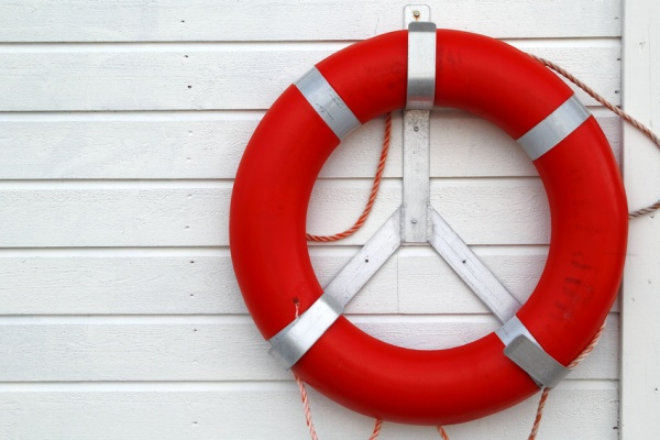 Lifebuoy on a wooden background wall construction